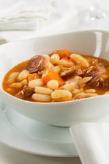 Bean stew served in an elegant white bowl