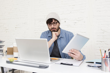 young hispanic attractive hipster businessman working at modern home office