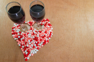 glass of wine and hearts