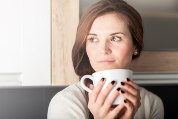 Woman with cup of coffee or tea, portrait