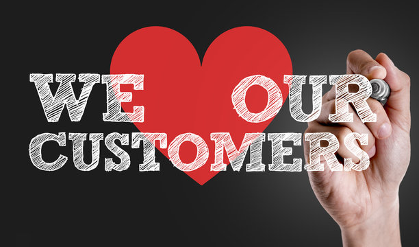 Hand writing the text: We Love Our Customers