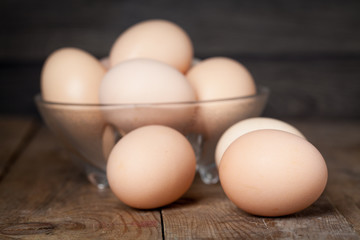 Chicken fresh brown eggs on wooden rustic table