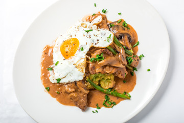 Veal with parsnip puree, asparagus, egg and miso mushroom sauce
