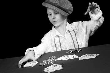Child is playing cards