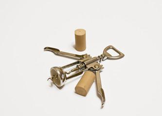 Metallic corkscrew / the composition consists a metallic corkscrew isolated on white background