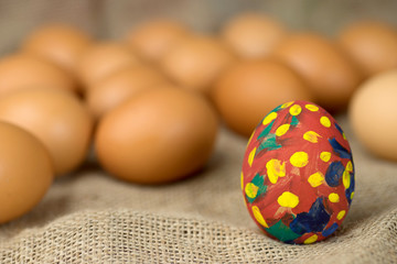 painted egg on burlap