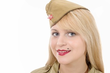 Portrait of pretty young woman in Russian military uniform, on w
