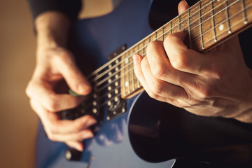 Men playing guitar close-up shot