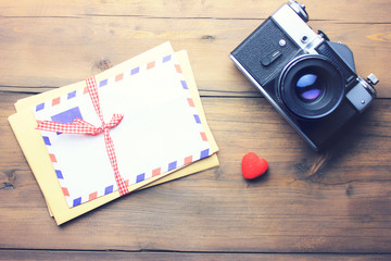 letter, camera and heart on table