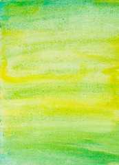 abstract watercolor background with yellow and green color brush