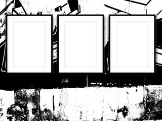 Close-up of three black picture frames on black and white ink splotchy background