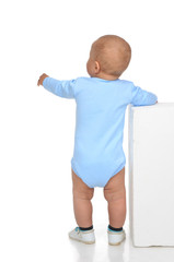 Rear view of caucasian full body one year infant baby boy toddle