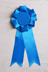Award ribbon on wooden background