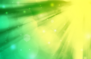 Green,yellow bokeh ray glitter defocused lights abstract beautiful background.