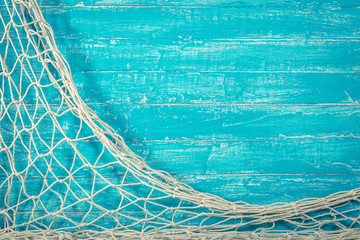 Fishing net on old blue board
