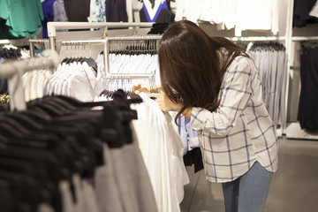 Women are choosing the clothes in the shop
