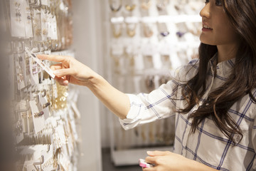 Young women are choosing the accessories in the shop