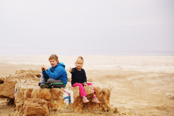 Portrait of 5 years girl with her autistic 8 years old brother o