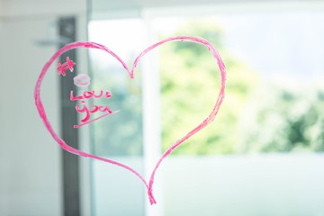 Heart on a mirror written with pink lipstick