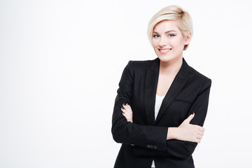 Happy businesswoman standing with arms folded
