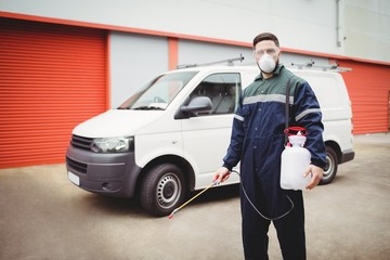 Handyman with insecticide standing