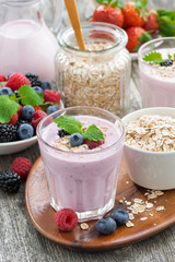 berry smoothie with oatmeal in a glass on table