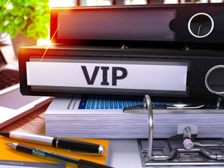 VIP - Very Important Person - Black Office Folder on Background of Working Table with Stationery and Laptop. VIP Business Concept on Blurred Background. VIP Toned Image. 3D.