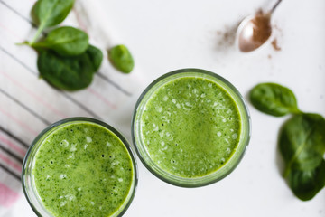 Two green smoothie in the glass