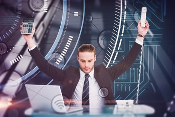 Composite image of businessman cheering holding calculator