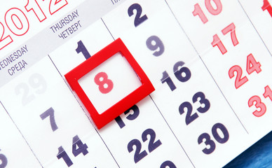 Sheet of wall calendar with red mark on 8 March - Woman day