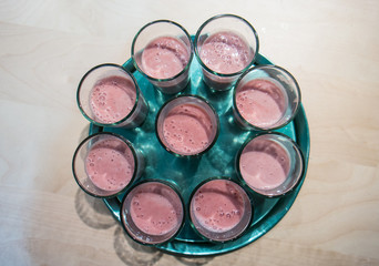 strawberry smoothie on a tray