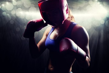 Composite image of portrait of female fighter with fighting pose