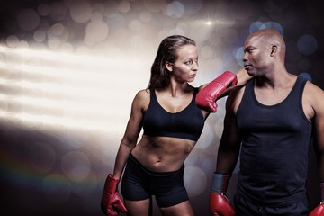 Composite image of male and female boxer looking at each other