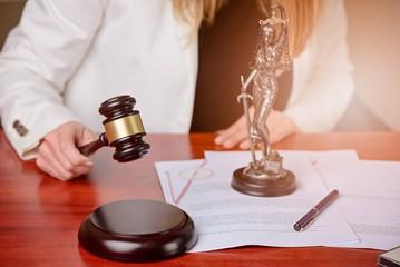 Woman holding judge gavel.