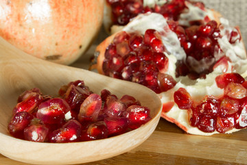 Pomegranate fruit over wooden table