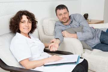 Depressed AND SAD middle aged man in session with therapist