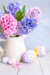 Bouquet of spring flowers and Easter Eggs