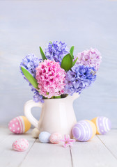 Happy Easter. Beautiful spring flowers. A bouquet of colorful hyacinth and painted eggs