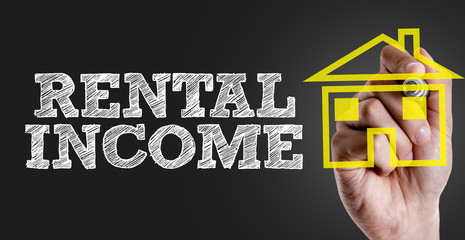 Hand writing the text: Rental Income