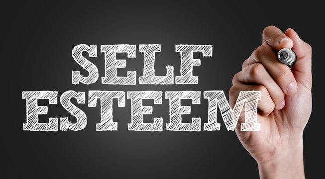Hand writing the text: Self Esteem