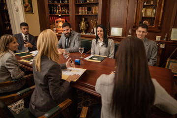 group of business people or lawyers - meeting in an office