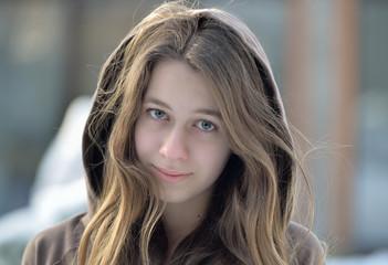 Outdoor portrait of beautiful teen girl.