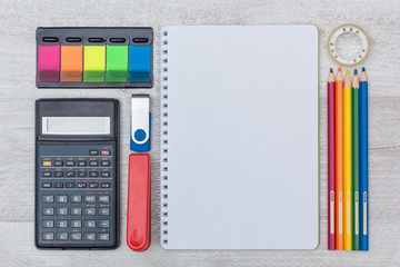 flat lay: notepad and calculator