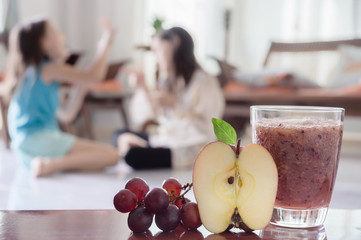 Red healthy smoothie with apple and grapes