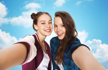 happy smiling pretty teenage girls taking selfie