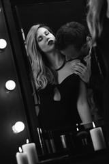 Romantic passionate couple in mirror
