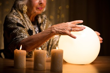 Woman's hands on crystal ball
