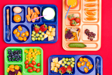 Four trays filled with fruit and vegetables