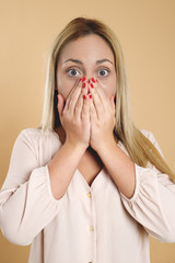 Attractive young blond woman is surprised