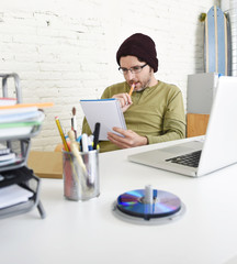 young hipster businessman working with computer in home office as creative freelancer